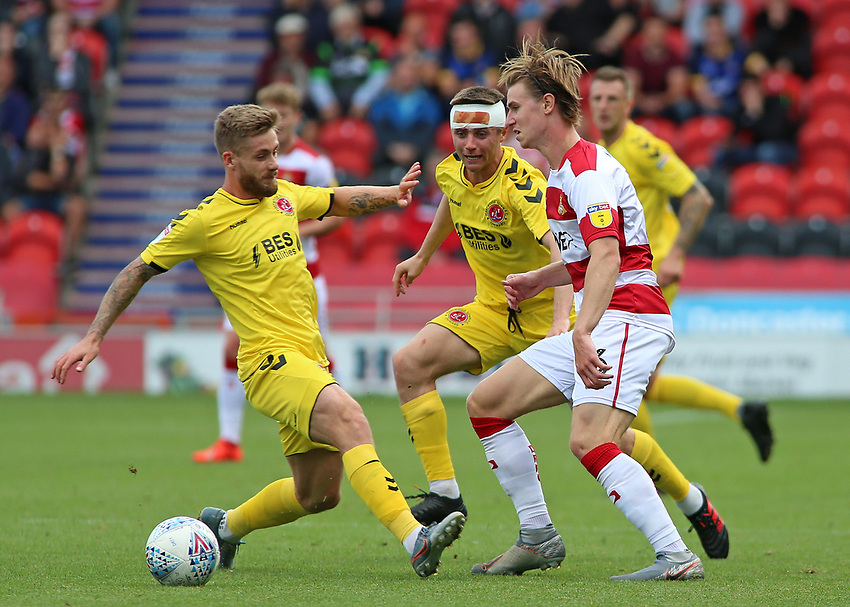 Fleetwood Town's Conor McAleny chases down Doncaster Rovers' Ben Sheaf<br /> <br /> Photographer David Shipman/CameraSport<br /> <br /> The EFL Sky Bet League One - Doncaster Rovers v Fleetwood Town - Saturday 17th August 2019  - Keepmoat Stadium - Doncaster<br /> <br /> World Copyright © 2019 CameraSport. All rights reserved. 43 Linden Ave. Countesthorpe. Leicester. England. LE8 5PG - Tel: +44 (0) 116 277 4147 - admin@camerasport.com - www.camerasport.com