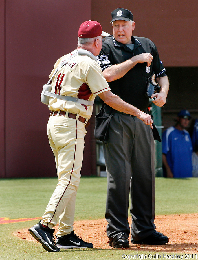 TALLAHASSEE, FL 4/24/11-FSU-DUKE BASE11 CH-Florida State's Head Coach Mike Martin, left, protests a call made by Home Plate Umpire Rick Darby during the Duke game Sunday at Dick Howser Stadium in Tallahassee. The Seminoles beat the Blue Devils 13-9...COLIN HACKLEY PHOTO