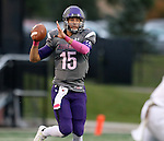 SIOUX FALLS, SD - OCTOBER 4: Luke Papilion #15 from the University of Sioux Falls eyes a receiver downfield against Concordia St. Paul in the first half of their game Saturday evening at Bob Young Field.(Photo by Dave Eggen/Inertia)