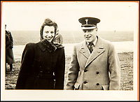 BNPS.co.uk (01202 558833)<br /> Pic: C&amp;T/BNPS<br /> <br /> Brenda with a unknown colleague at the airfiled in Moscow with Churchill in October 1944.<br /> <br /> A humble secretary's remarkable first hand archive of some of the most momentous events of WW2 has come to light.<br /> <br /> 'Miss Brenda Hart' worked in the Cabinet Office during the last two years of the war, travelling across the globe with the Allied leaders as the conflict drew to a close.<br /> <br /> Her unique collection of photographs and momentoes of Churchill, Stalin and other prominent Second World War figures have been unearthed after more than 70 years.<br /> <br /> The scrapbooks, which also feature Lord Mountbatten and Vyacheslav Molotov, were collated by Brenda Hart who, in her role as secretary to Churchill's chief of staff General Hastings Ismay, enjoyed incredible access to him and other world leaders.<br /> <br /> She also wrote a series of letters which give fascinating insights, including watching Churchill and Stalin shaking hands at the Bolshoi ballet in 1944, being behind Churchill as he walked out on to the balcony at the Ministry of Health to to wave to some 50,000 Londoners on VE day and even visiting Hitler's bombed out Reich Chancellery at the end of the war.<br /> <br /> This unique first hand account, captured in a collection of photos, passes, documents and letters are being sold at C&amp;T auctioneers on15th March with a &pound;1200 estimate.