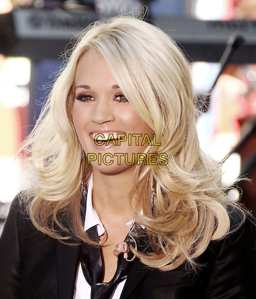 "CARRIE UNDERWOOD.performs live on the NBC's ""TODAY"" Show live from Rockefeller Center, New York, NY, USA, 30th July 2010..music country live on stage concert gig.portrait headshot  black jacket blazer white shirt tie smiling .CAP/ADM/AC.©Alex Cole/AdMedia/Capital Pictures."