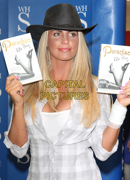 KATIE PRICE (Jordan).at a signing for her paperback 'Paradise' at WH Smith, Howard Centre, Welwyn Garden City, Herts, England, UK, .May 6th 2011..half length white vest top plaid checked shirt grey gray hat  wrist bandage  pink nails nail varnish polish .CAP/JIL.©Jill Mayhew/Capital Pictures