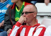 A dejected Sunderland fan during the Barclays Premier League match between Sunderland and Swansea City played at Stadium of Light, Sunderland