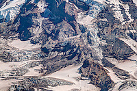 A close-up view of North Mowich Glacier, one of the 25 major glaciers found on Mount Rainier. on a warm August summer day. This massive river of ice moves very slowly down the mountain year after year, until it melts and becomes part of the North Mowich River system.