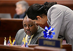 Nevada Assembly Democrats Jason Frierson and Olivia Diaz work on the Assembly floor at the Legislative Building in Carson City, Nev., on Monday, April 15, 2013. .Photo by Cathleen Allison