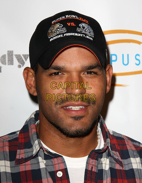 "AMAURY NOLASCO. Lupus LA Raises Awareness with ""Get Lucky for Lupus"" held At Andaz Hotel, West Hollywood, California, USA..February 25th, 2010.headshot portrait black stubble facial hair red white check baseball cap hat .CAP/ADM/KB.©Kevan Brooks/AdMedia/Capital Pictures."