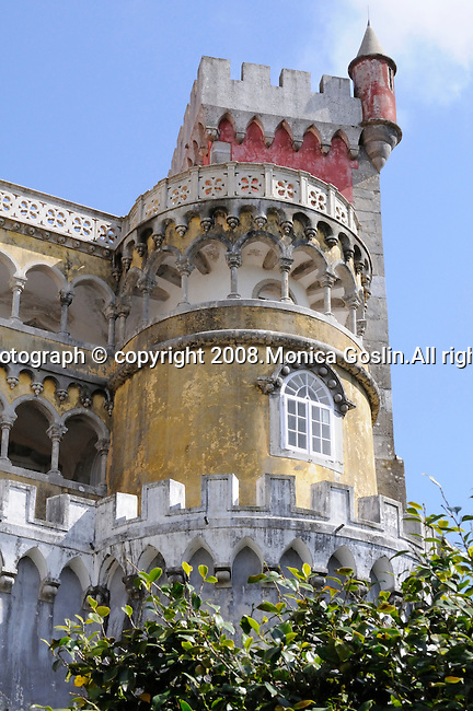 A yellow and pink tower at the Pena National Palace in Sintra, Portugal.