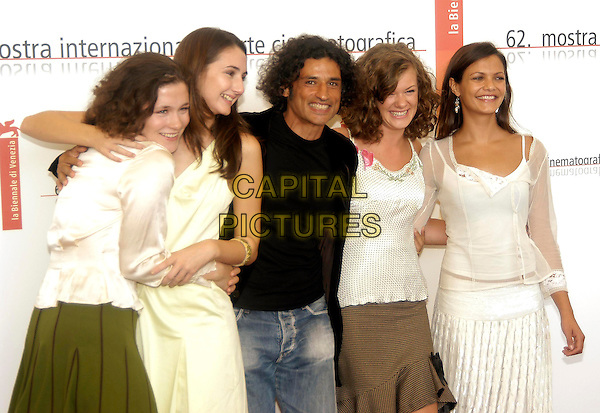 """ANNA MAGUIRE, HANNAH TAYLOR GORDON, ENRICO LO VERSO, MARY NIGHY & ANYA LAHIRI.Photocall of the film """"The fine art of Love"""",.62nd International Film Festival,.Venice, 31st August 2005.half length white top shirt dress skirt black denim jeans eye contact hug arms.www.capitalpictures.com.sales@capitalpictures.com.© Capital Pictures."""