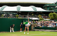 Alize Cornet<br /> <br /> Tennis - The Championships Wimbledon  - Grand Slam -  All England Lawn Tennis Club  2013 -  Wimbledon - London - United Kingdom - Monday 24th June  2013. <br /> &copy; AMN Images, 8 Cedar Court, Somerset Road, London, SW19 5HU<br /> Tel - +44 7843383012<br /> mfrey@advantagemedianet.com<br /> www.amnimages.photoshelter.com<br /> www.advantagemedianet.com<br /> www.tennishead.net