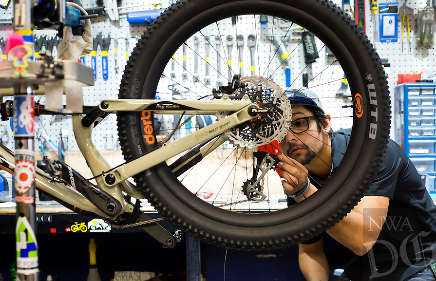 NWA Democrat-Gazette/JASON IVESTER<br /> Tony King works on a bicyle on Wednesday, Feb. 8, 2017, at Phat Tire Bike Shop in Bentonville.