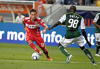 Chicago midfielder Daniel Paladini (11) makes a move to evade Portland defender Mamadou Danso (98).  The Portland Timbers defeated the Chicago Fire 1-0 at Toyota Park in Bridgeview, IL on July 16, 2011.