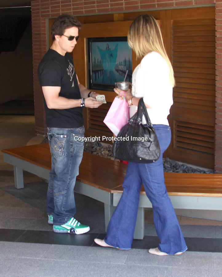 June 2nd 2011 ...Mark Wahlberg shopping with his wife & kid at Westfield Mall in Century city Los Angeles. Mark & his Rhea Durham waited for the valet parking & headed into there black SUV's. Mark was holding & carrying his kid most of the day. Rhea was carrying a black Chanel handbag purse & Mark was wearing a Bayvi Hawaii shirt ..AbilityFilms@yahoo.com.805-427-3519.www.AbilityFilms.com