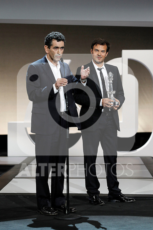 French director François Ozon (R) receives the Best Script award of the 60th San Sebastian International Film Festival for his film 'Dans La Maison' (In the House) next to Spanish author Juan Mallorga (L) during the Awards Gala in the 60th San Sebastian Donostia International Film Festival - Zinemaldia.September 29,2012.(ALTERPHOTOS/ALFAQUI/Acero)
