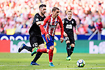 Antoine Griezmann of Atletico de Madrid (R) plays against Paulo Oliveira of SD Eibar (L) during the La Liga match between Atletico Madrid and Eibar at Wanda Metropolitano Stadium on May 20, 2018 in Madrid, Spain. Photo by Diego Souto / Power Sport Images