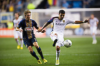 Javier Morales (11) of Real Salt Lake is marked by Brian Carroll (7) of the Philadelphia Union. The Philadelphia Union and Real Salt Lake played to a 0-0 tie during a Major League Soccer (MLS) match at PPL Park in Chester, PA, on August 24, 2012.