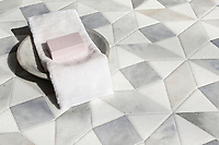 Esmeralda Grand, a stone hand-cut cut mosaic, shown in venetian honed Allure, Snow White, and Cashmere, is part of the Semplice® collection for New Ravenna.