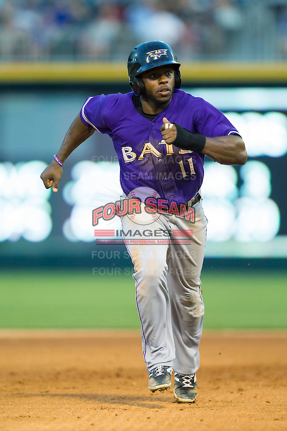 Jason Bourgeois (11) of the Louisville Bats takes off for third base during the game against the Charlotte Knights at BB&T Ballpark on June 26, 2014 in Charlotte, North Carolina.  The Bats defeated the Knights 6-4.  (Brian Westerholt/Four Seam Images)