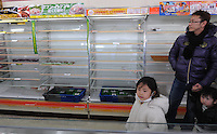 Empty shelves at a small supermaket in Fukushima city, about 60 km from the Fukushima Daiichi Nuclear Power Plant. Plant was damaged during the  Earhquake and following Tsunami that struck Japan on 11th March 2011.  With no power or running water and limited supplies of food, people in affected regions are surviving on little food and water, many supermarket stores are queued up with clients buying food and beverages and the stores didn't have many supplies left. <br /> 17 Mar 2011