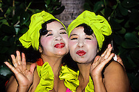 Portrait of two middle aged sexy Latina sisters with reed lipstick and yellow dress foto, reise, photograph, image, images, photo,<br />