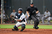 GCL Rays catcher Julio Meza (16) fields a throw as umpire Trey Ward gets in position during a Gulf Coast League game against the GCL Pirates on August 7, 2019 at Charlotte Sports Park in Port Charlotte, Florida.  GCL Rays defeated the GCL Pirates 4-1 in the first game of a doubleheader.  (Mike Janes/Four Seam Images)