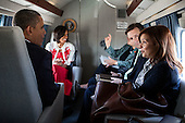 United States President Barack Obama talks with Alyssa Mastromonaco, Deputy Chief of Staff for Operations, and Principal Deputy Press Secretary Josh Earnest as First Lady Michelle Obama talks with her Chief of Staff, Tina Tchen, aboard Marine One en route to Joint Base Andrews, Maryland, April 27, 2012. .Mandatory Credit: Pete Souza - White House via CNP