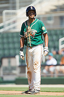 Carlos Lopez (7) of the Greensboro Grasshoppers looks at the home plate umpire in disbelief after having been called out on strikes during the game against the Kannapolis Intimidators at CMC-NorthEast Stadium on September 1, 2014 in Kannapolis, North Carolina.  The Grasshoppers defeated the Intimidators 7-4.  (Brian Westerholt/Four Seam Images)