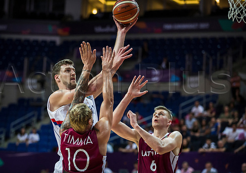 1st September 2017, Fenerbahce Arena, Istanbul, Turkey; FIBA Eurobasket Group D; Serbia versus Latvia; Center Ognjen Kuzmic #32 of Serbia in action against Forward Janis Timma #10 of Latvia and Power Forward Kristaps Porzingis #6 of Latvia during the match
