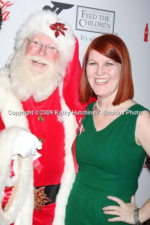 Kate Flannery & Santa Claus  Tom Connaghan.arriving at the 2009 Hollywood Christmas Parade .Hollywood Roosevelt Hotel.Los Angeles,  CA.November 29, 2009.©2009 Kathy Hutchins / Hutchins Photo.