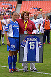26 April 2003: Monica Gerardo (15) receives a framed jersey from Freedom general manager Katy Button before her final game prior to retiring. The Washington Freedom tied the Atlanta Beat at RFK Stadium in Washington, DC in a regular season WUSA game..Mandatory Credit: Scott Bales/Icon SMI
