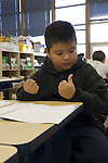 Oakland CA 2nd grade latino student taking standardized Oakland School District math test