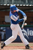 30 july 2010: Gaspard Fessy of France makes contact during Italy 9-2 win over France, in day 6 of the 2010 European Championship Seniors, at TV Cannstatt ballpark, in Stuttgart, Germany.
