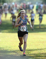 NWA Democrat-Gazette/ANDY SHUPE<br /> Fayetteville's Grace Litzinger comes in to the finish line Saturday, Oct. 5, 2019, in the girls El Caliente during the Chile Pepper Cross Country Festival at Agri Park in Fayetteville. Visit nwadg.com/photos to see more photographs from the races.