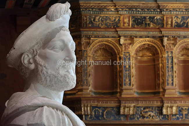 Bust of King Francois I, 1494-1547, made 1850 in plaster by Alfred Jean Baptiste Halou, 1829-91, in the Salle du Roi, or King's Hall, used by Francois I for meals and audiences, on the first floor of the Francois I wing, built early 16th century in Italian Renaissance style, in the Chateau Royal de Blois, built 13th - 17th century in Blois in the Loire Valley, Loir-et-Cher, Centre, France. The bust was acquired 1861 for the Musee des Beaux-Arts de la Ville de Blois, housed 1850-69 in the Francois I wing and since 1869 on the first floor of the Louis XII wing of the chateau. Behind is the carved and gilded fireplace. The chateau has 564 rooms and 75 staircases and is listed as a historic monument and UNESCO World Heritage Site. Picture by Manuel Cohen