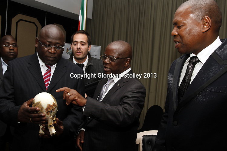 DURBAN - 6 August 2013 - Andre Kimbuta (centre, glasses), the governor of the Kinshasa province comments on the present ath Guy Matondo Kingolo (left), the provincial Minister of Finance, Economy, Trade, Industry, Small and Medium Enterprises of the Democratic Republic of the Congo's Kinshasa Province received from Zweli Mkhize, the premier of South Africa's KwaZulu-Natal province as Andre Kimbuta (centre, glasses), the governor of the Kinshasa province looks on. Picture: Giordano Stolley