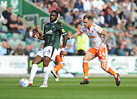 Plymouth Argyle's Yann Songo'o under pressure from Blackpool's Harry Pritchard<br /> <br /> Photographer Kevin Barnes/CameraSport<br /> <br /> The EFL Sky Bet League One - Plymouth Argyle v Blackpool - Saturday 15th September 2018 - Home Park - Plymouth<br /> <br /> World Copyright &copy; 2018 CameraSport. All rights reserved. 43 Linden Ave. Countesthorpe. Leicester. England. LE8 5PG - Tel: +44 (0) 116 277 4147 - admin@camerasport.com - www.camerasport.com
