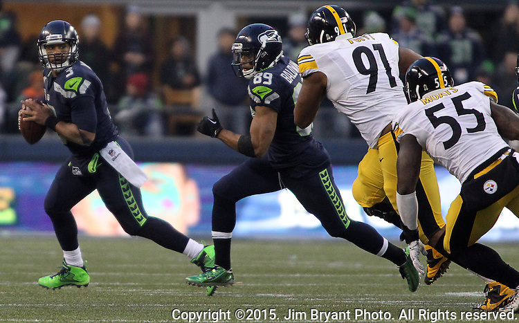 Seattle Seahawks Russell Wilson (3) rolls out looking to pass to wide receiver Doug Baldwin (89) against the Pittsburgh Steelers at CenturyLink Field in Seattle, Washington on November 29, 2015.  The Seahawks beat the Steelers 39-30.      ©2015. Jim Bryant Photo. All Rights Reserved.