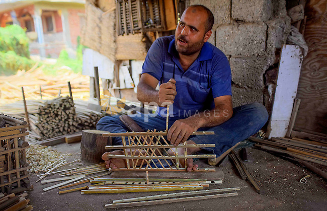 An Egyptian man weaves straw-traditional products, at their workshop, in Cairo, Egypt, on September 7, 2016. Photo by Amr Sayed