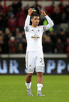 Kyle Naughton of Swansea thanks supporters after the Barclays Premier League match between Swansea City and Bournemouth at the Liberty Stadium, Swansea on November 21 2015