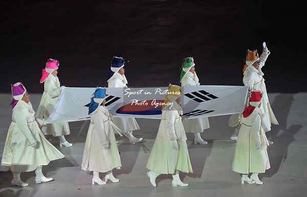 The Korean flag enters the stadium. Opening Ceremony. Pyeongchang2018 winter Olympics. Olympic stadium. Pyeongchang. Republic of Korea. 09/02/2018. ~ MANDATORY CREDIT Garry Bowden/SIPPA - NO UNAUTHORISED USE - +44 7837 394578