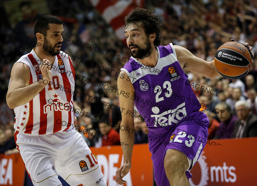 BELGRADE, SERBIA - DECEMBER 22: Sergio Llull (R) of Real Madrid in action against Branko Lazic (L) of Crvena Zvezda during the 2016/2017 Turkish Airlines EuroLeague Regular Season Round 14 game between Crvena Zvezda MTS Belgrade and Real Madrid at Aleksandar Nikolic Hall on December 22, 2016 in Belgrade, Serbia. (Photo by Srdjan Stevanovic/Getty Images)