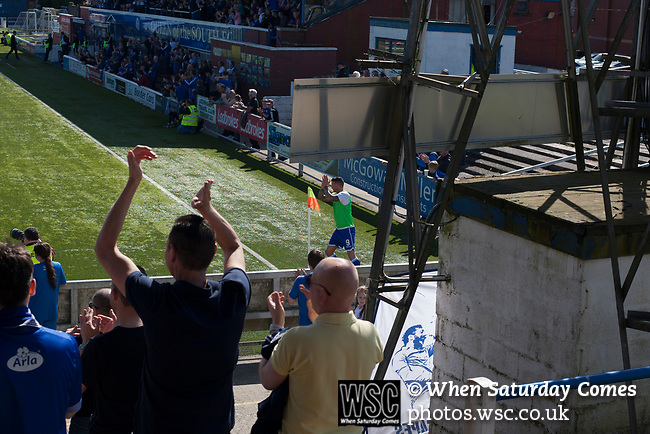 Home fans cheering substitute striker Derek Lyle from the terracing at Palmerston Park, Dumfries as Queen of the South hosted Dundee United in a Scottish Championship fixture. The home has played at the same ground since its formation in 1919. Queens won the match 3-0 watched by a crowd of 1,531 spectators.