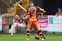 Picture by Alex Whitehead/SWpix.com - 12/05/2018 - Rugby League - Ladbrokes Challenge Cup - Castleford Tigers v St Helens - Mend-A-Hose Jungle, Castleford, England - St Helens' Kyle Amor is tackled by Castleford's Alex Foster and Liam Watts.