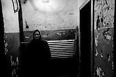 Kirov, Russia  .March 1999.A pensioner waits for the elevator in her apartment building..