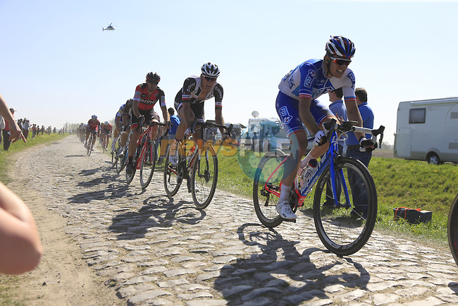 The peloton including Arnaud Demare (FRA) FDJ on pave sector 17 Hornaing a Windignies during the 115th edition of the Paris-Roubaix 2017 race running 257km Compiegne to Roubaix, France. 9th April 2017.<br /> Picture: Eoin Clarke | Cyclefile<br /> <br /> <br /> All photos usage must carry mandatory copyright credit (&copy; Cyclefile | Eoin Clarke)