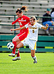 14 October 2010: University of Hartford Hawks forward Caroline Dixon (10), a Sophomore from Manchester, England, battles University of Vermont Catamount midfielder Jess Herbst, a Sophomore from Webster, NY, at Centennial Field in Burlington, Vermont. The Hawks defeated the Lady Cats 6-2 in America East play. Mandatory Credit: Ed Wolfstein Photo