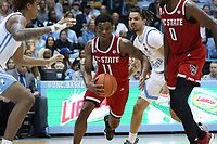 CHAPEL HILL, NC - FEBRUARY 25: Markell Johnson #11 of North Carolina State University drives the lane during a game between NC State and North Carolina at Dean E. Smith Center on February 25, 2020 in Chapel Hill, North Carolina.