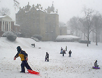 Children enjoy the snow by sledding, Thursday, December 5, 2002 in Doylestown, Pennsylvania. The Philadelphia region was expecting 4-6 inches of snow from it's first major winter storm in two years. (Photo by William Thomas Cain/photodx.com)