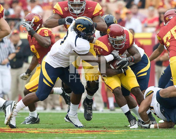 D.J. Holt of California tackles Allen Bradford of USC during the game at LA Memorial Coliseum in Los Angeles, California.  USC defeated California, 48-14.