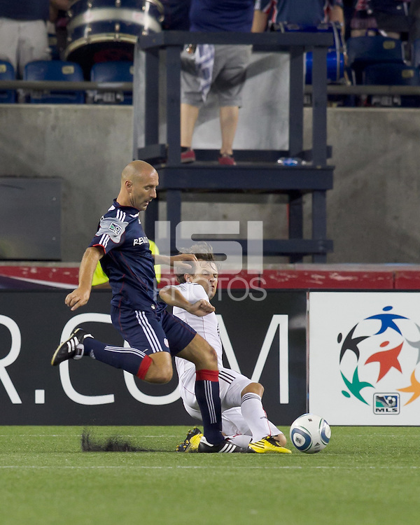 DC United defender Carey Talley (8) tackles New England Revolution forward Ilica Stojica (9) as he drives for the net. The New England Revolution defeated DC United, 1-0, at Gillette Stadium on August 7, 2010.