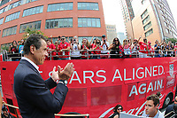 NEW YORK, NY - JULY 10: New York Governor Andrew Cuomo claps as a VIP bus passes before the start of a ticker tape parade for the United States Women's National Soccer team along Broadway down the Canyon of Heroes on Broadway on July 10, 2019 in New York, NY.